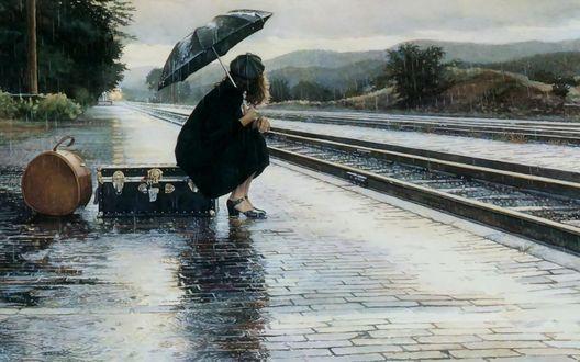 Обои Девушка сидит на чемодане под дождём на железной станции в ожидании поезда