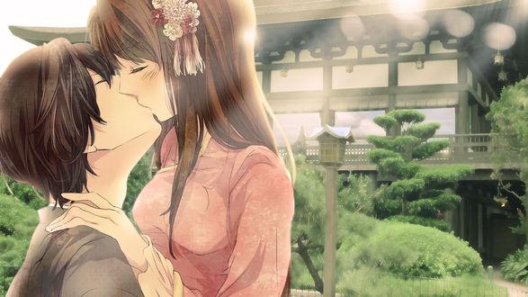Обои Девушка целуется с парнем