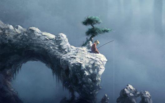 Обои Одинокий рыбак в шляпе сидит на скале
