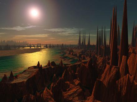 Обои Закат солнца на морском берегу, усыпанному фантастическими каменными возвышенностями