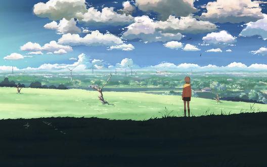 Обои Девушка стоит на пустыре и смотрит вдаль