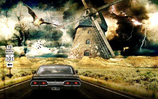 Обои Мир снов: по дороге мчится черный автомобиль, на его пути стоит гигантская мельница, в небе летает огромная летучая мышь, дорогу освещают сверкающие молнии (to north us 101)