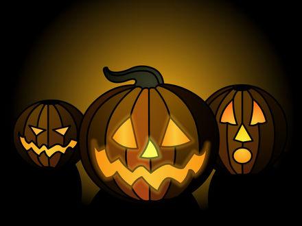 Обои К празднику Хэллоуин. Светящиеся тыквы с вырезанными на них мордочками