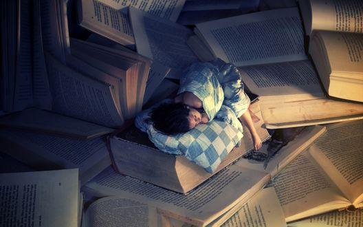 Обои Девушка спит среди книг