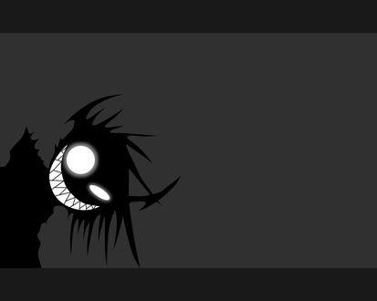 Обои Зловещая улыбка черной фигуры