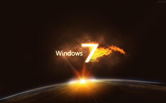 Обои Огненный логотип windows 7 над планетой в космосе
