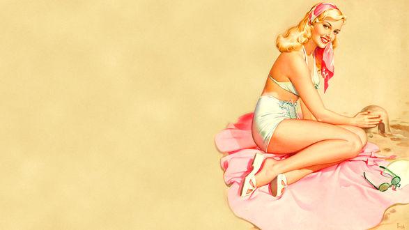 Обои Нежная блондинка строит замок на песке, сидя на розовом покрывале
