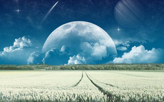 Обои Огромная луна на синем небе над белым полем