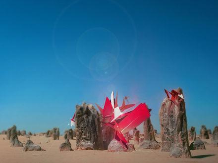 Обои Огромные камни в пустыне рядом с абстрактными фигурами
