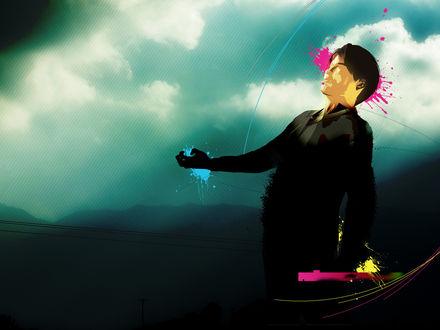 Обои Человек стоит под дождём из разноцветных красок