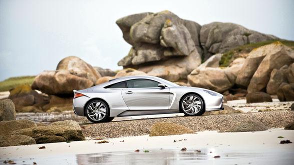 Обои Электрический суперкар Exagon Motors Furtive e-GT серого цвета стоит у скал