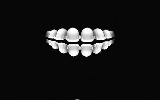 Обои Белые зубы на черном фоне