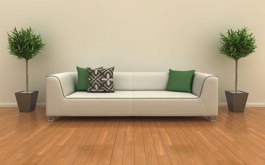 Обои Белый диван с подушками стоит у стены между двумя декоративными деревьями