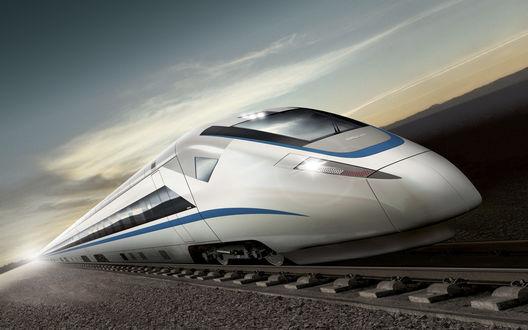 Обои Скоростной поезд мчится по рельсам