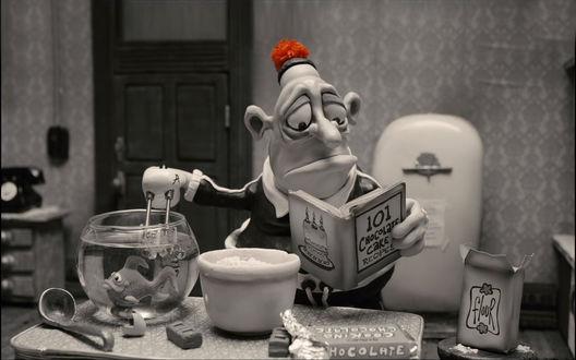 Обои Зачитавшийся Макс, герой пластилинового анимационного фильма Мэри и Макс / Mary and Max, за приготовлением тортиа (101 chocolate cake recipes / 101 рецепт приготовления шоколадного торта, flour / мука, chocolate / шоколад)