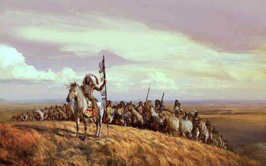 Обои Вождь индейцев, сидя на коне, указывает путь своему племени