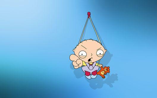 Обои Стьюи Гриффин из мультсериала 'Гриффины / Family Guy' в скверном настроении злобно тыкает пальцем