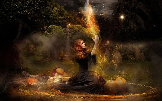 Обои Рыжеволосая ведьма колдует на кладбище в ночь Хеллоуина