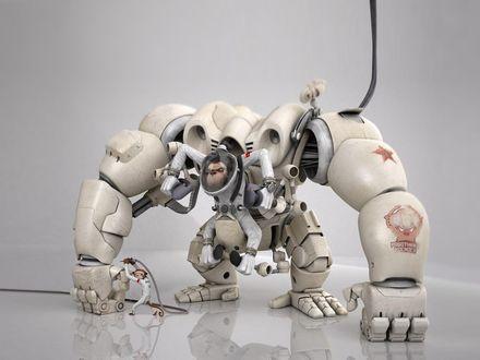 Обои Огромным роботом управляют обезьяны, на руке робота написано 'Работники Космоса'