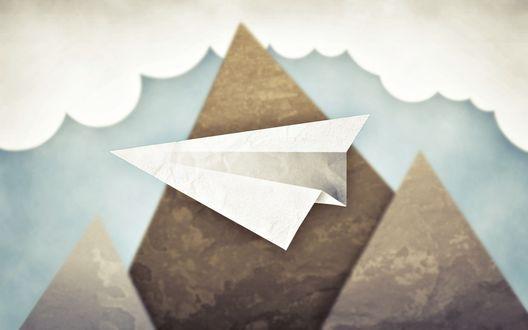 Обои Летящий среди облаков над горами бумажный самолетик