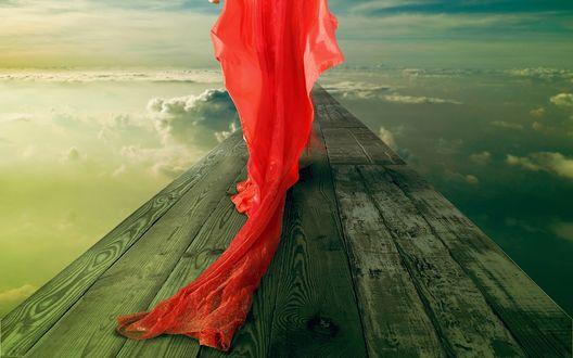 Обои Девушка в красном платье идет по досочкам в небе