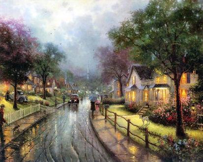 Обои Дождь в небольшом городке, где по дорогам ездят ретро машины, по асфальту ходят люди с зонтами, по обеим сторонам дороги уютные дома. Художник Томас Кинкейд