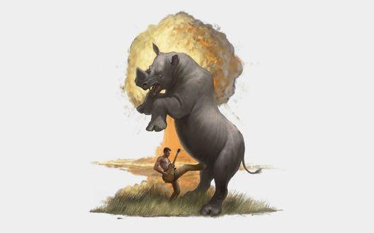 Обои Огромный носорог и мужчина с электрогитарой сражаются на траве, на фоне ядерного взрыва