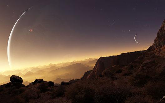 Обои Звезды и соседние планеты в ночном небе над скалами, покрытыми туманом