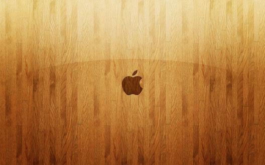 Обои Логотип Apple на фоне ламинированного деревянного покрытия