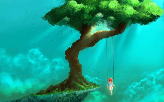 Обои Рыжая девушка катается над обрывом на качелях, привязанных к дереву