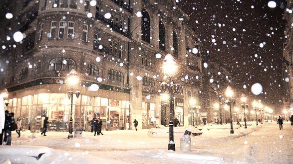 Обои Снегопад в вечернем городе
