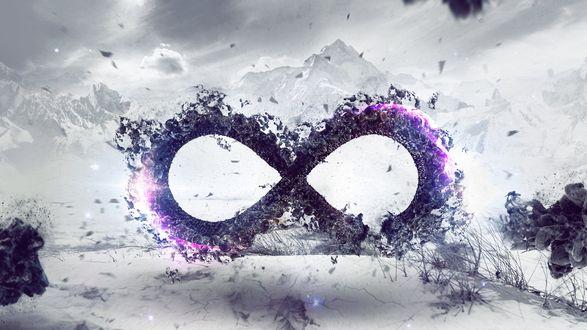 Обои Символ бесконечности созданный из обрывков бумаги и динамиков на фоне серых гор