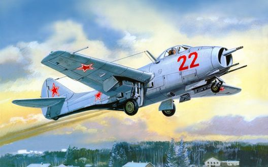 Обои Один из первых советских реактивных истребителей МиГ-9 с бортовым номером 22 производит взлет