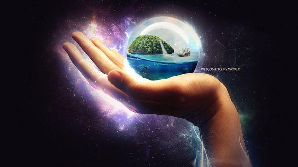 Обои Женская рука держит на ладони стеклянный шарик внутри которого плавает парусник на фоне водопада и голубого неба (Welcom to my world)