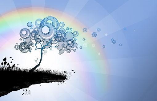 Обои Дерево с кругами вместо листвы стоит на краю скалы на фоне радуги