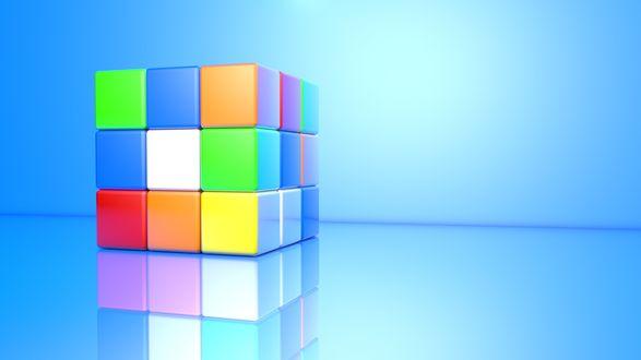 Обои Кубик Рубика на голубом фоне и его отражение