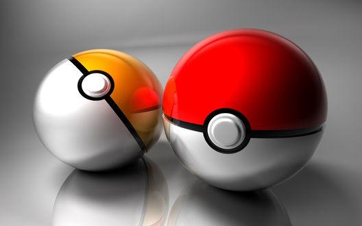 Обои Два Покебола / Pokeballs из аниме Покемон / Pokemon, серебристо-желтый и серебристо-красный, лежат на стеклянной поверхности
