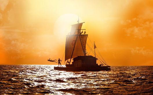 Обои Путешественники, совершающие переход на плоту с парусами через океан, купаются на фоне утреннего восходящего солнца