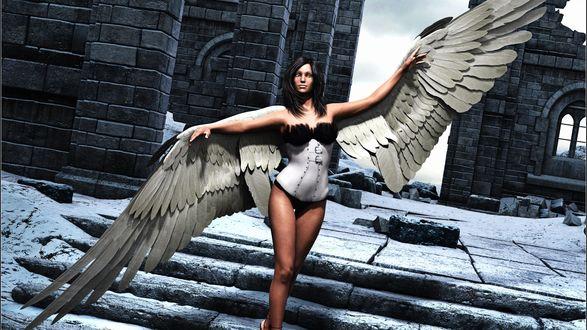 Обои На заснеженных развалинах замка живет девушка с ангельскими крыльями