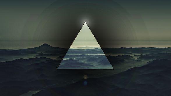 Обои Треугольник на фоне гор и неба