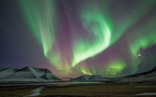 Обои Северное сияние над снежными горами, Исландия / Iceland