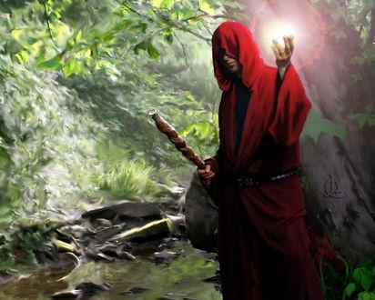 Обои Маг в красной накидке с посохом на фоне природы