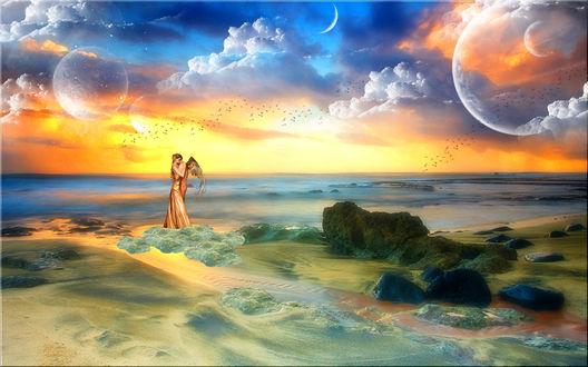 Обои Девушка в длинном платье стоит в обнимку с мужчиной - ангелом на камнях на фоне невероятной красоты моря и неба