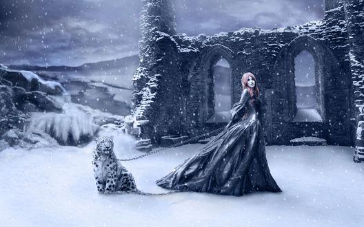 Обои Девушка со снежным барсом на цепи стоит на фоне разрушенного здания