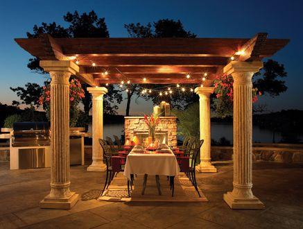 Обои Стол, накрытый к ужину в беседке у камина с видом на озеро