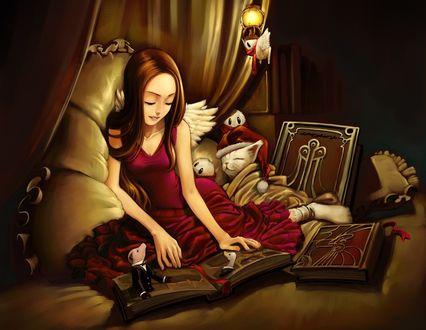 Обои Девушка ангел сидит на кровати, разглядывая страницы открытой книги, рядом лежат еще две книги, спит белый котенок, укрытый покрывалом, сидят два каких-то существа, одно существо летает около зажженного светильника