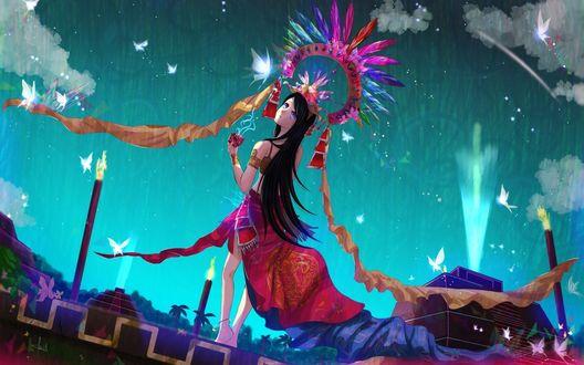 Обои Темноволосая девушка с короной стоит держа в руке магический куб на фоне ночного неба и летающих бабочек