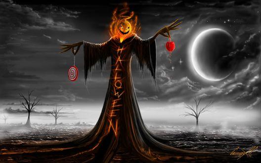 Обои Чучело с головой в виде тыквы, в черном рваном плаще, на котором огненными буквами написано Halloween / Хэллоуин, на фоне голых деревьев, луны и пасмурного неба