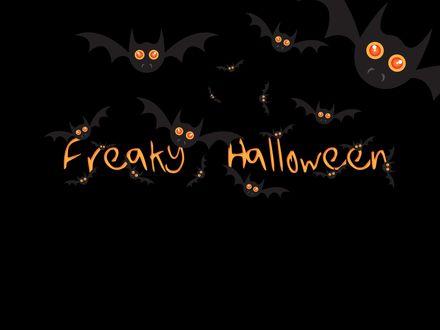 Обои Летучие мыши и надпись Freaky Halloween / Необычного Хэллоуина на черном фоне