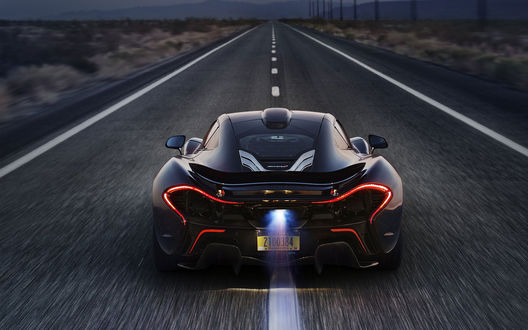 Обои Черный автомобиль McLaren P1 / МакЛарен Р1 едет по дороге